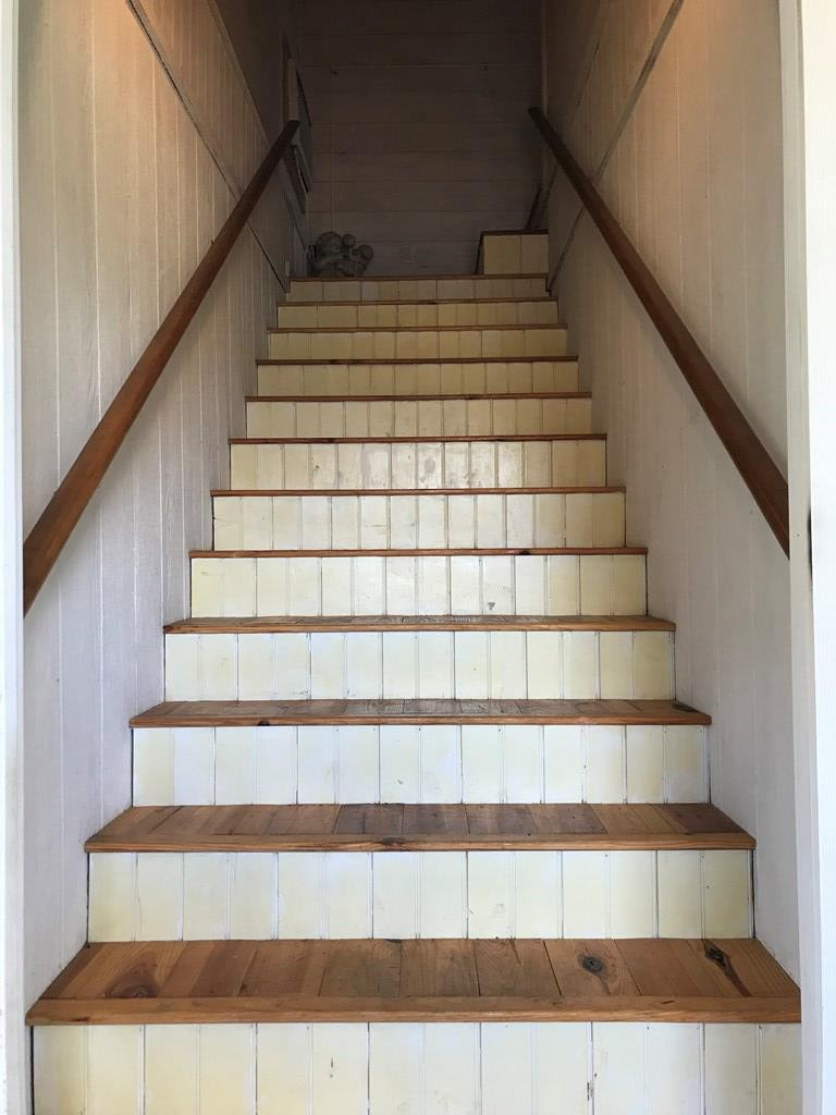 Stairs to apartment in detached garage