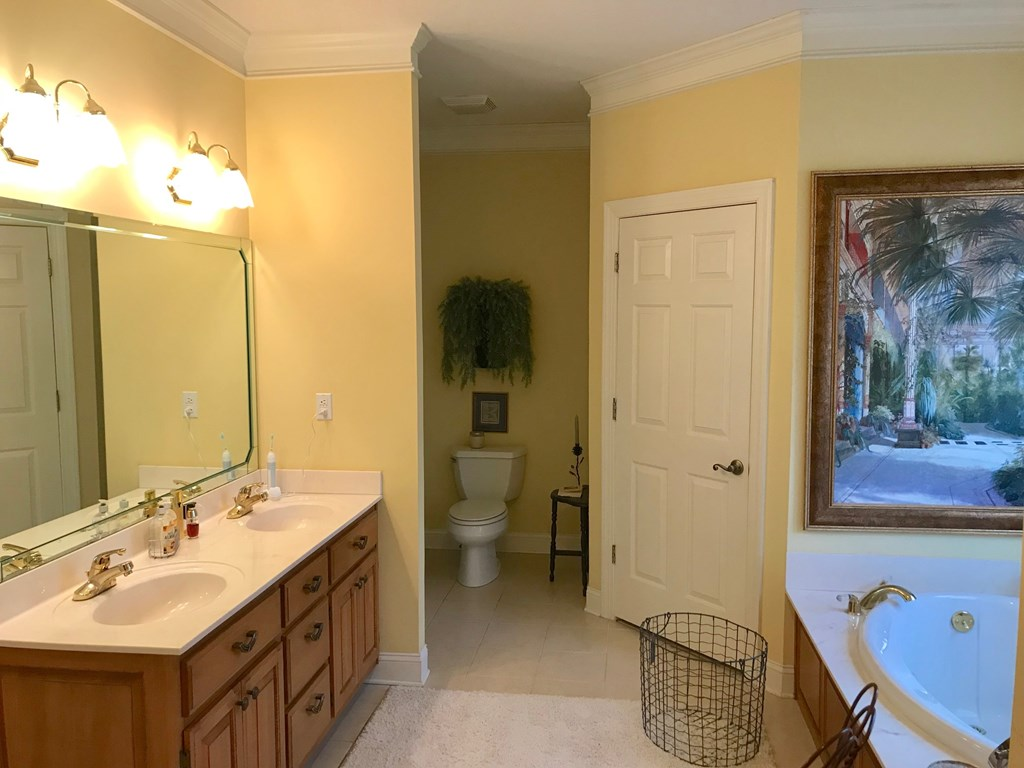 Master bath has his and her closets