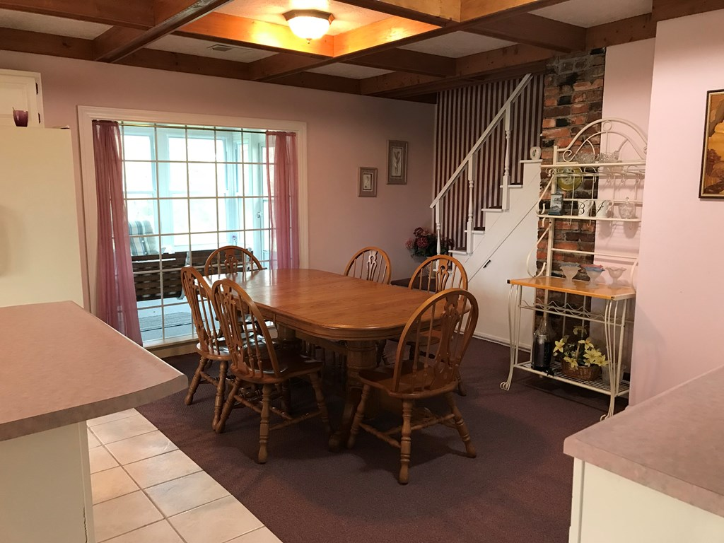 Large eat in kitchen with back stairway