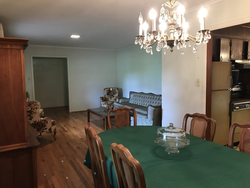 Additional view of formal dining room and living r