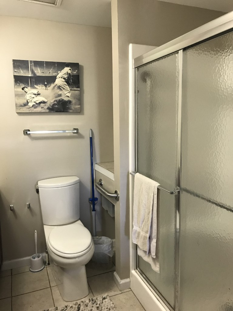 Stand up shower in bathroom adjoining bedroom 1