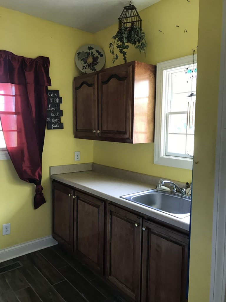 Laundry room with counter for folding and sink