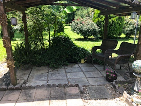 Covered patio and fish pond