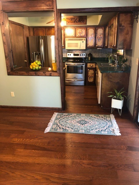 Kitchen with stainless appliances and pantry