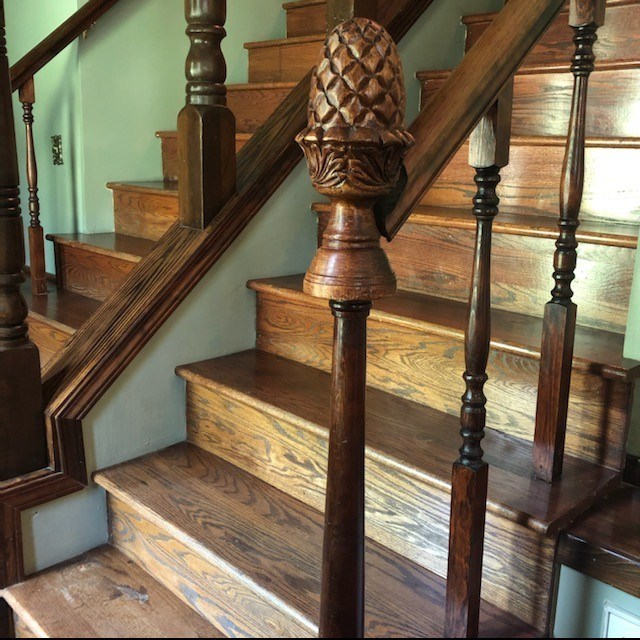 Beautiful custom double staircase welcomes you as