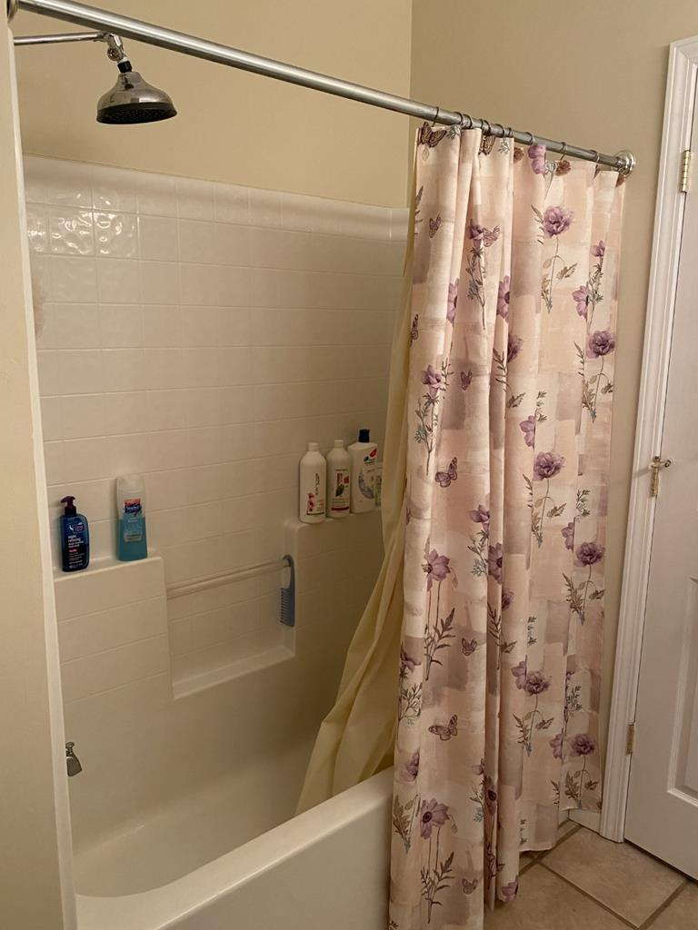 View of tub/shower in hall bath