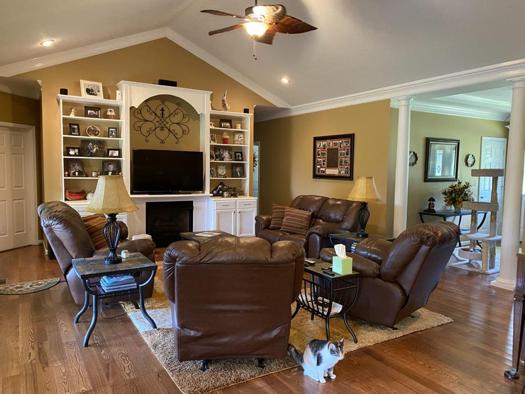 Large family room with built in shelves